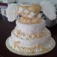 Memorial Cake wings made out of gumpaste , heart RKT