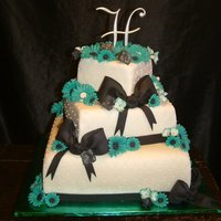 Wedding Cake- Colors Teal, Black, And White This was a three tier wedding cake. The brides colors were Teal, Black, and White. And the flowers she was wanting were daisies and black...