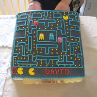Pac-Man Cake  Pac-Man cake for my son's birthday. Chocolate cake (single layer) iced in buttercream and covered in black MMF. Details are in royal...