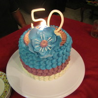 The Big 50   WASC cake filled with homemade pineapple jelly. Iced with buttercream petal technique. This was so easy. No muss, no fuss.