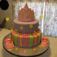 Leah's Crown Cake Two tier, WASC cake filled with apricot jam and a sugar cookie layer. Iced with chocolate ganache and covered in MMF. Gumpaste shoes and...