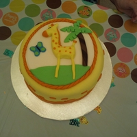 Giraffe Baby Shower Cake A baby shower cake done for a friend who was doing her baby's room in a jungle theme (mainly giraffes). Chocolate cake with raspberry...