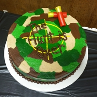 Camo Groom's Cake This is a groom's cake that I did for my sister's wedding. It's a banana cake covered in camo buttercream. The shotgun...