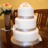 Tiered Wedding Cake This is my first wedding cake. I did it for 2 friends of ours that got married. I used the brides dress as inspiration. It's 3 tiers (...
