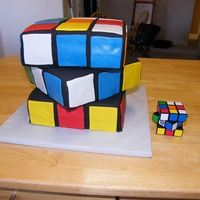Rubik's Cube Cake A cake I did for an 80's party we went to. It's 3 tiers of WASC cake covered in fondant. Each layer had it's own cake board...