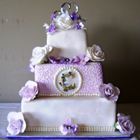 Victorian Garden In Shades Of Violet Fondant covered cake with gumpaste flowers. Everything is edible, except for the silver hearts on the topper. Butterflies are edible ink on...