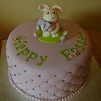 Happy Easter Cake Hand sculpted bunny, red velvet cake, cream cheese filling, fondant and dragees.