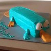 Perry The Platypus So fun and simple. I took a 13x9 cut in half the long way and stacked. Iced in teal BC, molded the tail and beak from MMF, and figure piped...