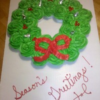 Cupcake Christmas Wreath  Inspired by many of the ones I've seen on this site! Red Velvet Cupcakes/Buttercream icing, Red Hots for holly berries, and Hershey&#...