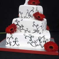 1317606777.jpg   Black and white wedding cake with hand painted swirling vine.