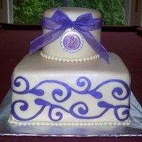 Purple Scroll Bridal Shower Cake   Pink champagne cake with bavarian cream filling. Used my cricut to cut out the scroll design. Thanks for looking.