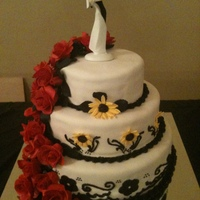 Roses And Sunflower Wedding Cake Made chocolate, white, and marble cake covered in Fondant. Gumpaste Red Roses.