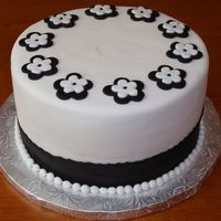 Black And White Anniversary Cake White Cake with Fondant icing and appliques. Made for an anniversary/wedding celebration. The Daughter married on her parents Wedding...