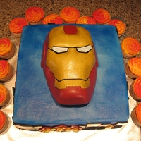 Ironman Cake rice cripsy treat ironman covered in fondant, buttercream covered white cake with matching cupcakes, very fun to make!