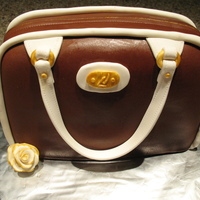 Purse Cake 1st purse cake, chocolate mmf, definitely fun and want to try again.