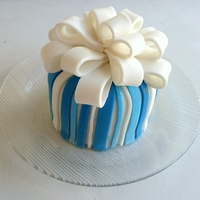 Blue Fondant Mini Bow Fruitcake   A mini fruitcake covered with fondant and bow detail