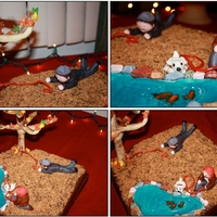 Friends, Dogs . . . Squirrel Chocolate Cake; toasted coconut as soil; blue piping gel for water; and fondant figures.