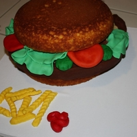 Burger Unfrosted lemon cake; patty is rice crispies covered in chocolate fondant and the rest is also fondant.