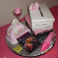 Sex And The City All covered with fondant. Everything edible except for the martini glass and the cd cover and candle. My own design! Made for my bff!!!