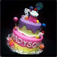 Candy Themed Cake All fondant with RKT cupcake