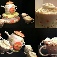 Tea Party Themed Cake Cups are made out of gumpaste and then the cupcakes are put inside. The teapot is a combo of a 6 inch round and the ball pan.