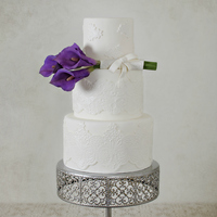 Simply White With A Touch Of Violet This cake was featured in CC' Magazine back in August. The flowers are gum paste. TFL