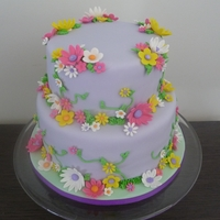 Flowers This was a 8 inch and 6 inch vanilla cake covered in fondant with gumpaste flowers.