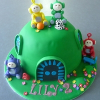 Teletubbies A vanilla rainbow cake. All decorations are fondant.