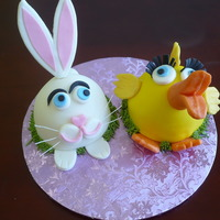 Easter Bunny & Duck Butter cake covered with buttercream and fondant. All accents are fondant/gumpaste and modeling chocolate. These are based on Susan...