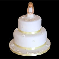Olivia's Communion Cake two tiered cake chocolate and lemon with a handmade communion girl reflecting her dress etc...