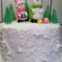 Snowman Cake Snowman cake with frosting and gumpaste decorations.