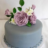 Lavender Roses Simple cake I made. I also made the sugarpaste flowers.