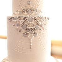 Bling Two tiered fondant cake with edible jewels.