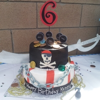 Pirate Cake This was a Pirate theme cake done for a 6th Birthday party. Cake was done with butter cream frosting, and accents done in fondant. It was a...