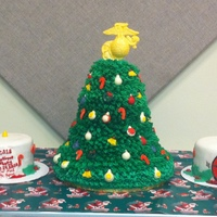 Christmas Tree Cake   This cake was fun but stressful to make lol.. In the end the tree stood 2ft tall.