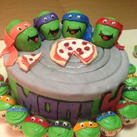 Ninja Turtles   Both fondant and butter cream. The turtles are fudge.10 in cake and mini cupcakes.