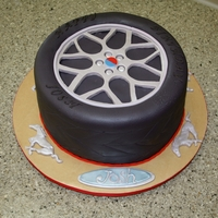 Ford Mustang Tire   Fondant covered cake with fondant decor.