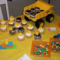 Construction Theme Cupcakes construction theme for boys baby shower. whipped icing with real building blocks and crushed oreos to look like dirt.