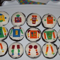 Robot Cupcakes   whipped icing with fondant accents