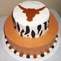 Texas Longhorns Cake   My camera doesn't do the colors justice. 2 tiers, (12 and 8), whipped icing with fondant accents.