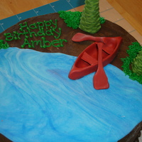 Canoeing  Birthday cake for a girl who loves to go camping and canoeing. Chocolate cake with peanut butter mousse filling, dark chocolate buttercream...