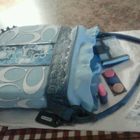 Coach Purse ALMOND CAKE COVER WITH BUTTERCREAM ICING AND FONDANT . GUMPATE ACCESORIES.