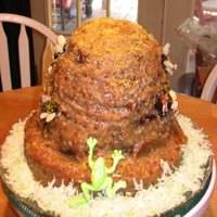 Bee Hive Cake German Chocolate cake shaped as a bee hive, a frog on the side along with bees