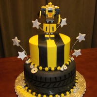 "Bumblebee Transformer My son't 4th birthday cake. 8"" and 6""/ Bottom is fondant covered and top is buttercream with fondant stripes. Topper is a..."