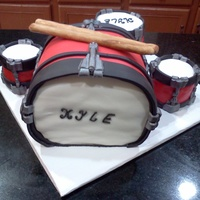 Drum Set This is all vanilla cake with vanilla buttercrea. The smaller drums were made with Rice krispy Treats. All accents were 50/50 gumpaste and...