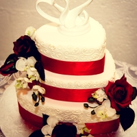 Sweet Love!   Simple stacked cake finished with Rolled Fondant, Ribbon and silk flowers and light scroll work.