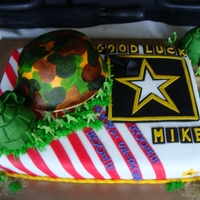 I'm In The Army Now! a going away cake for a new recruit...helmet is gumpaste and hand painted...mom wanted the army men but everything else is edible....