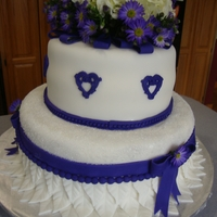 Purple And White Bridal Shower  fondant leave detail with cystalized sugar, the bridesmaids will be in purple, the flowers are real i would have done them in sugar it was...
