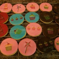 Stamped/embossed Cookies NFSC with Fondant. I used some stamps I bought @ Michaels, then painted with gel colors thinned with vodka.