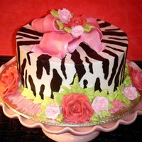Jaycee's Zebra Stripe Birthday Cake I had so much fun doing this cake! Since I don't charge for my cakes, I was given free reign to do whatever I wanted. I know this has...